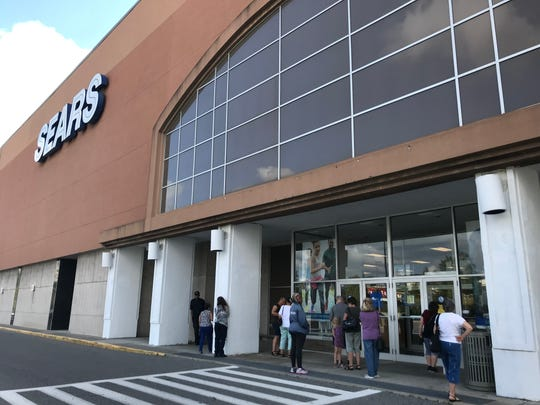 Shoppers waited outside Sears at Cross County Shopping Center before the store's opening at 9:30 a.m. Thursday, June 6, 2019.