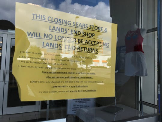 The flier at the Sears store at Cross County Shopping Center notifies its customers about the store's closing.