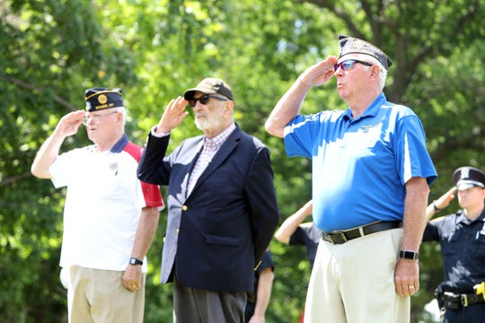 Veterans Tom Markham, right, John Murphy and John Gray salute during a wreath presentation ceremony in commemoration of the 75th anniversary of D-Day at a monument by the Camp Shanks Museum June 6, 2019 in Orangeburg. Camp Shanks was the largest point of embarkation for soldiers headed for Europe during World War II.