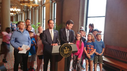 Sen. David Carlucci (center) discusses his bill requiring all children be vaccinated before enrolling in summer camp. Joining him: Sen. Brad Holyman (right), the primary sponsor of legislation that would end all non-medial exemptions for vaccinations.
