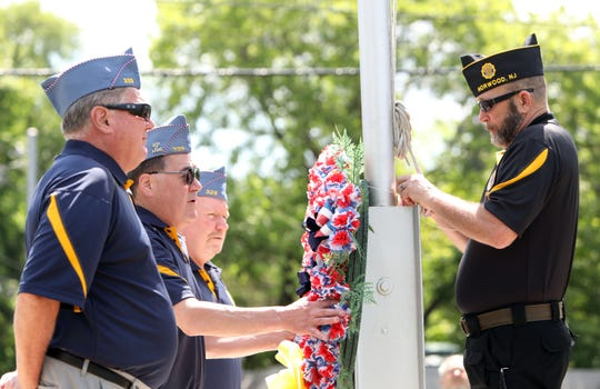Members of the Sons of American Legion Squadron 329 in Pearl River Dan Murphy, left, Kevin O'Rourke, and Richard Halpin along with Michael Penfold of American Legion Post 272 in Norwood, NJ, present a wreath in commemoration of the 75th anniversary of D-Day at a monument by the Camp Shanks Museum June 6, 2019 in Orangeburg. Camp Shanks was the largest point of embarkation for soldiers headed for Europe during World War II.