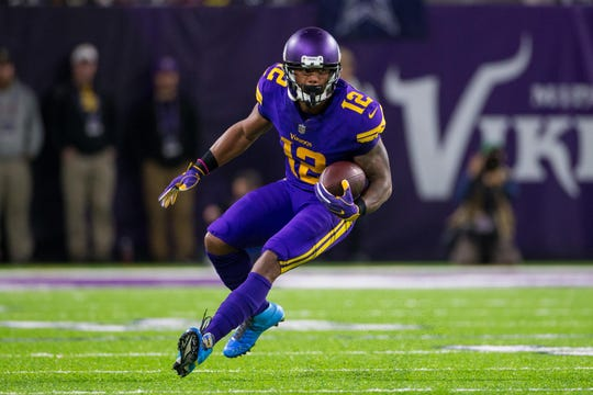 Minnesota Vikings wide receiver Charles Johnson (12) runs after the catch in the second quarter against the Dallas Cowboys at U.S. Bank Stadium in Minneapolis Dec. 1, 2016.