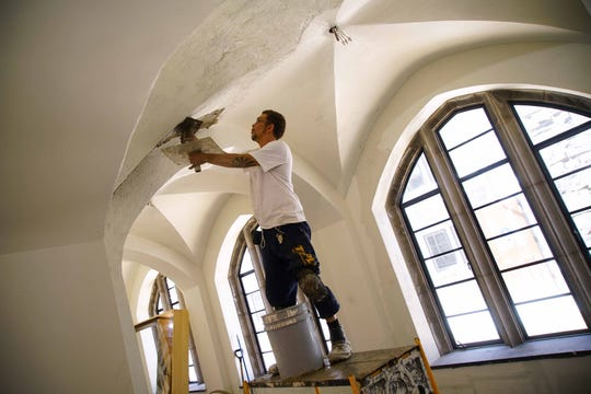 Workers continue the restoration and transformation of the former Cathedral Church of St. John that is being turned into Village of St. John, a 53-apartment living facility for seniors of low and moderate income.