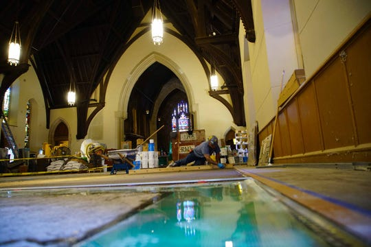 A worker installs a terrazzo floor in the main chapel of the Cathedral Church of St. John on Concord Pike that is under renovation. The church opened in 1858 and the last service in the church was held in 2012.