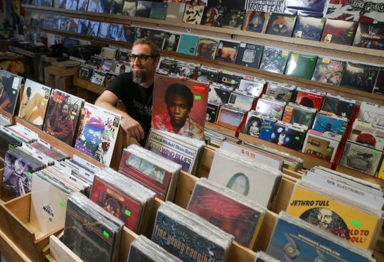 Todd Brewer, co-owner of Rainbow Records (with his wife, Miranda) at the Newark institution's new location in Pomeroy Station a few blocks up Main Street from its former spot. The store is hosting a grand reopening Saturday but is now open for business at the new location.