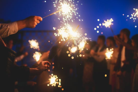 Never lean over a sparkler or firework when lighting the fuse.