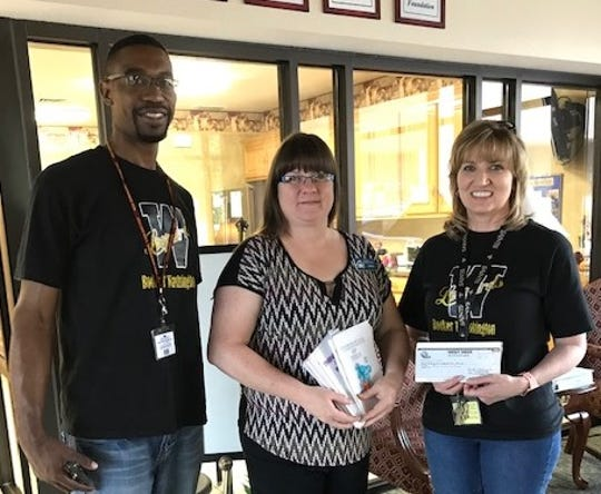 "Students at Booker T Washington School, K-5th grade, chose Rathgeber Hospitality House as one of the annual fund-raising projects. They donated $220 in cash and also colored ""Thinking of You"" cards to give to houseguests. Rathgeber House is a place for families to stay while they have a loved one receiving medical care in Wichita Falls. Pictured L to R: Maurice Jordan-Student Success Coordinator, Libbie Wright RHH House Manager, and Kristin Schreck-School Counselor."