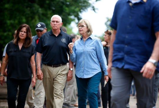 Vice President Mike Pence and his wife,  Karen, tour homes with Tulsa City Commissioner Karen Keith after storms left damage in the city Tuesday.