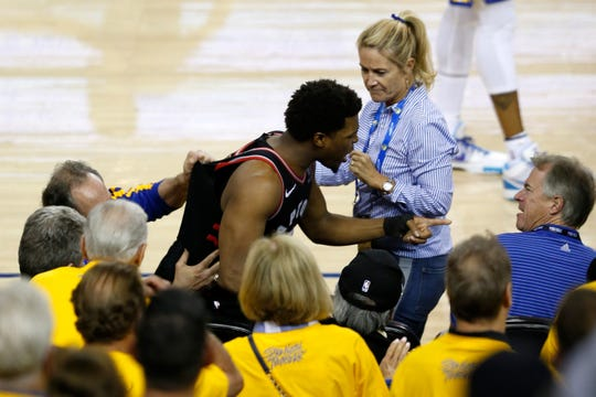 Kyle Lowry of the Toronto Raptors interacts with a fan during Game 3 of the NBA Finals.