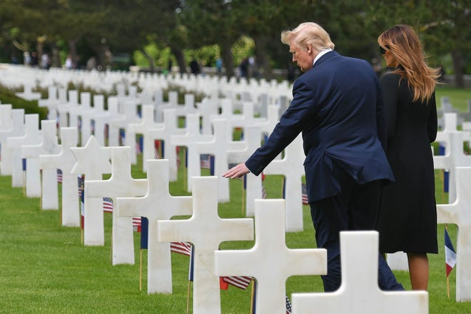 US President Donald Trump (L) and US First Lady Melania Trump (R) visit graves  after a French-US ceremony at the Normandy American Cemetery and Memorial in Colleville-sur-Mer, Normandy, northwestern France, on June 6, 2019, as part of D-Day commemorations marking the 75th anniversary of the World War II Allied landings in Normandy. (Photo by MANDEL NGAN / AFP)MANDEL NGAN/AFP/Getty Images ORIG FILE ID: AFP_1HA5PZ