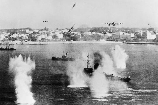 Allied forces' military planes bombing enemy boats in order to prepare the Allied troops landing aimed at fighting the German Wehrmacht.