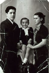 Young Luciano Pavarotti with his parents Fernando and Adele in this Easter shot taken in 1939 in Modena, Italy.