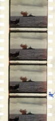 The USS Texas battleship fires shells from its 14-inch guns toward Omaha Beach in Normandy, France, on D-Day, June 6, 1944, in this color film strip.