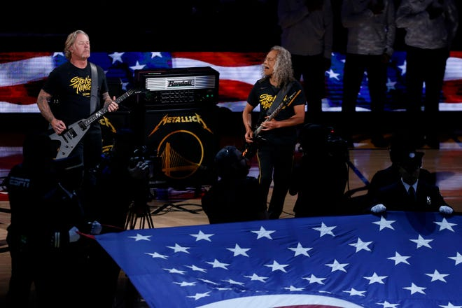 Metallica performs the national anthem  before the NBA Finals game three Wednesday.
