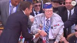 French President Emmanuel Macron helped World War II veteran Russell Pickett stand during the ceremony to commemorate the 75th anniversary of D-Day.