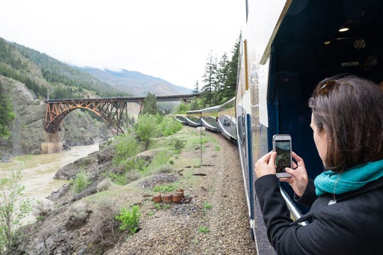 Jennifer Franklin snaps a photo from the GoldLeaf Service coach's outdoor viewing platform.