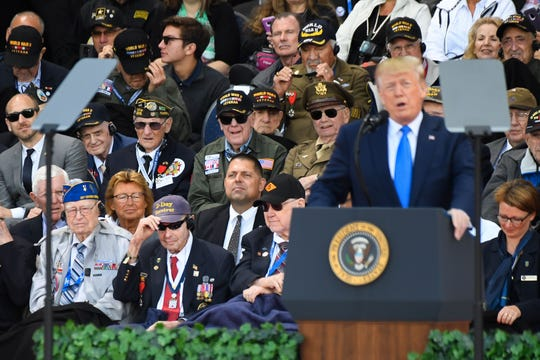 US WWII veterans listen to US President Donald Trump delivering a speech during a French-US ceremony at the Normandy American Cemetery and Memorial in Colleville-sur-Mer, Normandy, northwestern France, on June 6, 2019, as part of D-Day commemorations marking the 75th anniversary of the World War II Allied landings in Normandy. (Photo by Damien MEYER / AFP)
