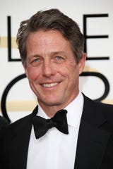 Hugh Grant poses at the Golden Globe Awards in 2017.