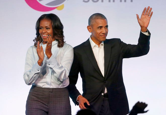 In this Oct. 31, 2017 file photo, former President Barack Obama, right, and former first lady Michelle Obama appear at the Obama Foundation Summit in Chicago.