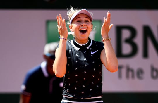American Amanda Anisimova celebrates victory during her quarterfinal match against Simona Halep at the French Open.