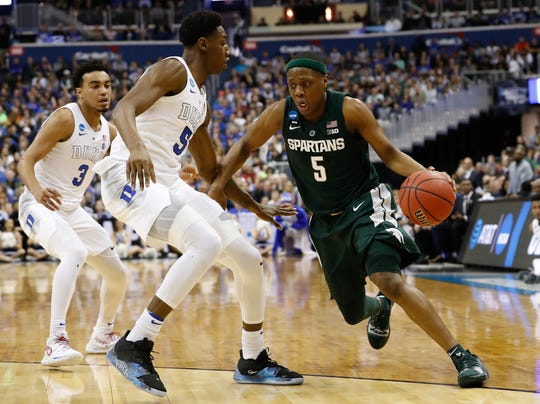 Michigan State guard Cassius Winston  drives to the basket against Duke during the Elite Eight of the 2019 NCAA tournament.