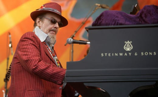 In this April 26, 2008 file photo, Dr. John performs during the 2008 New Orleans Jazz & Heritage Festival in New Orleans. The family of the Louisiana-born musician known as Dr. John says the celebrated singer and piano player who blended black and white musical influence with a hoodoo-infused stage persona and gravelly bayou drawl, has died. He was 77. A family statement released by his publicist says Dr. John, who was born Mac Rebennack, died early Thursday of a heart attack.