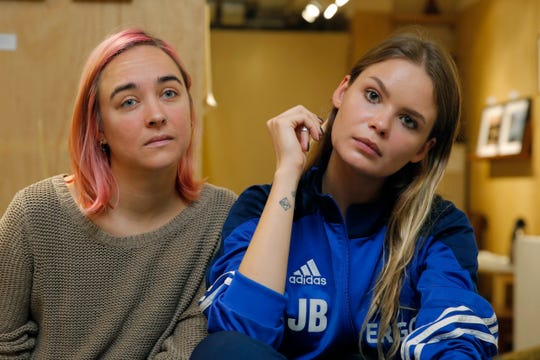 In this Nov. 3, 2018 file photo, two members of Russian punk band and political activists Pussy Riot, Veronica Nikulshina, right, and Olga Kuracheva attend a dialogue on art and freedom of expression, in response to the cancellation of Badiucao's exhibition in Hong Kong.