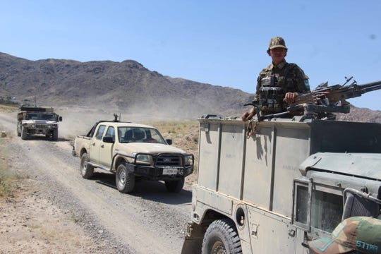 Afghan security forces patrol the Khakriz district in Kandahar, Afghanistan, in early June, shortly after it was cleared of Taliban militants.