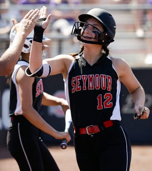 Seymour's Chloe Evans (12) celebrates after scoring a run against Ellsworth during a Division 2 state semifinal on June 7, 2019, at Goodman Softball Complex in Madison.
