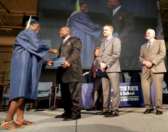Mardia Adams receives her diploma from the Rev. Alvin Dupree, a member of the Appleton Area School District Board of Education, during the 2019 Appleton North High School commencement ceremony Thursday. Dupree's speech, which included references to Christianity, has sparked controversy in the district and community.