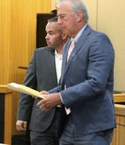 Former Long Branch police officer Patrick Joyce (left) is shown with his attorney Robert Norton after he was sentenced to a years probation for an offense related to an assault on a woman at a party.  He was sentenced by Judge Paul X. Escandon in State Superior Court in Freehold Friday, June 7, 2019.