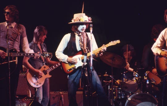"Bob Dylan, center, in a photo by Ken Regan in the film ""Rolling Thunder Revue: A Bob Dylan Story by Martin Scorsese."""