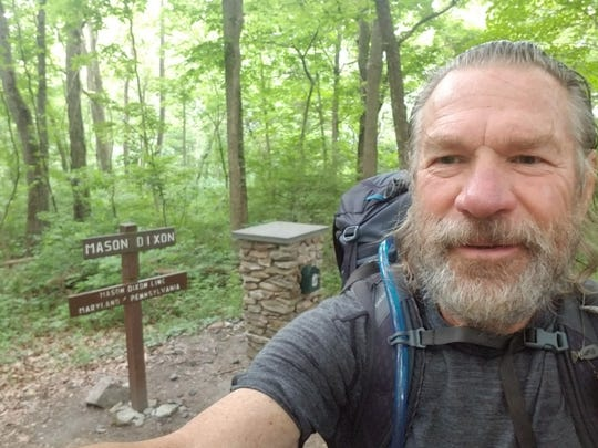 Roger Hoden at the Mason-Dixon line between Maryland and Pennsylvania.