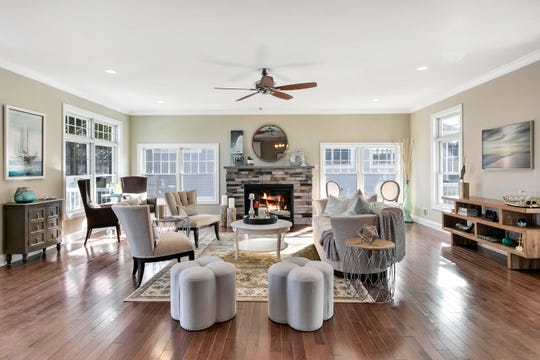 The Living Room features a custom ledge stone fireplace and hardwood flooring.