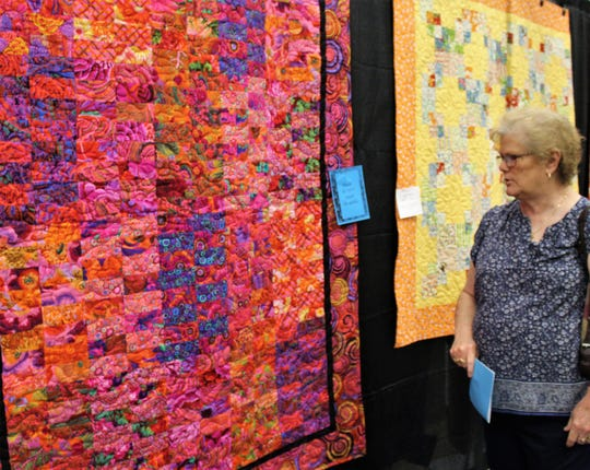 Lavada Tucker and two friends slowly made their way from aisle to aisle of quilts at the Stars Over Abilene 25th Regional Quilt Show at the Abilene Convention Center. The event concludes Saturday.