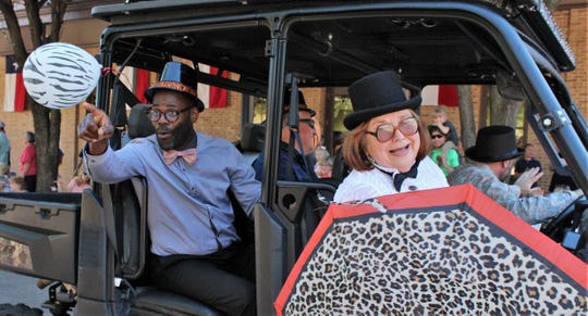 Abilene City Council incumbent Kyle McAlister, back right, drives (while waving) three other members in Thursday's Storybook Parade in downtown Abilene. From left are newly elected Travis Craver, with Shane Price to his left, and Councilwoman Donna Albus. McAlister is seeking a third term and in a runoff against challenger Cory Clements, whom Albus defeated in 2017.