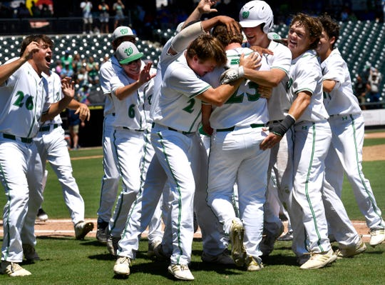 Wall High School players celebrate teammate Gage Weishuhn's game-winning hit which allowed Caleb Heuertz to score the winning run against Kirbyville in Friday's UIL Class 3A state semifinal game June 7, 2019. Wall will play in the state final Saturday at Dell Diamond in Round Rock.