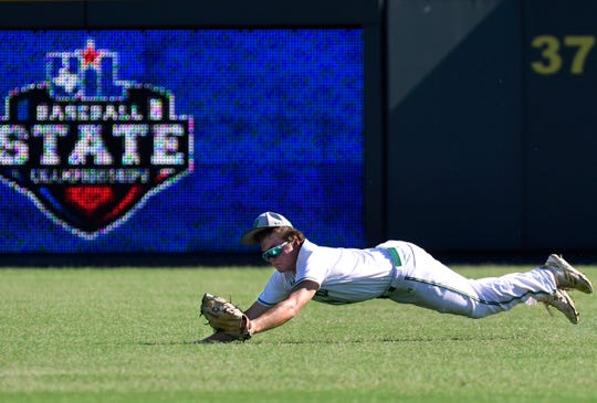 Wall center fielder Colton Diebitsch holds the ball in his glove as he falls to the ground after making a diving catch during Friday's UIL Class 3A state semifinal game against Kirbyville on June 7, 2019. Wall won at Round Rock's Dell Diamond, 5-4.