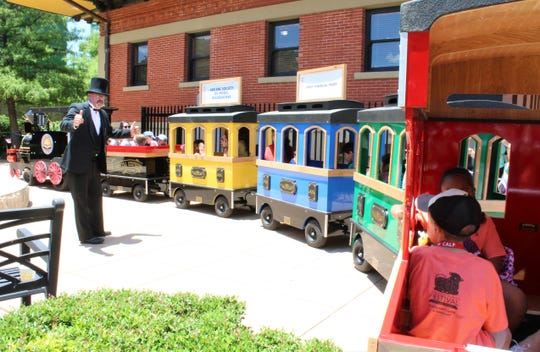 REPORTER-NEWS FILE PHOTO - Conductor Cecil Walston prepares riders on the Storybook Express, with Jim Gibson driving. The train traveled Everman Park, one of many activities at the Children's Art & Literacy Festival on June 7, 2019.