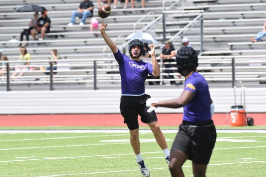 Wylie quarterback Jaxon Hansen throws a pass on the run against Lockhart during Pool A play at the Abilene 7-on-7 SQT on Friday. The Bulldogs beat Lockhart 39-0 to go 3-0 and win Pool A at Bulldog Stadium.