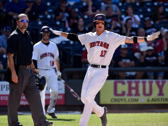 Colleyville Heritage's Bobby Witt Jr. waves his arms after scoring the first run during Thursday's Class 5A state semifinal game against Corsicana.