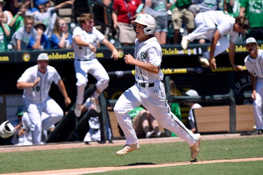 The Wall dugout empties and fans cheer as Caleb Heuertz scores the game-winning run during Friday's UIL Class 3A state semifinal game against Kirbyville June 7, 2019. The final score at Round Rock's Dell Diamond was 5-4.