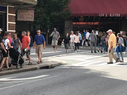 The corner of Haywood Street and Battery Park Avenue on a crowded day in June 2019.