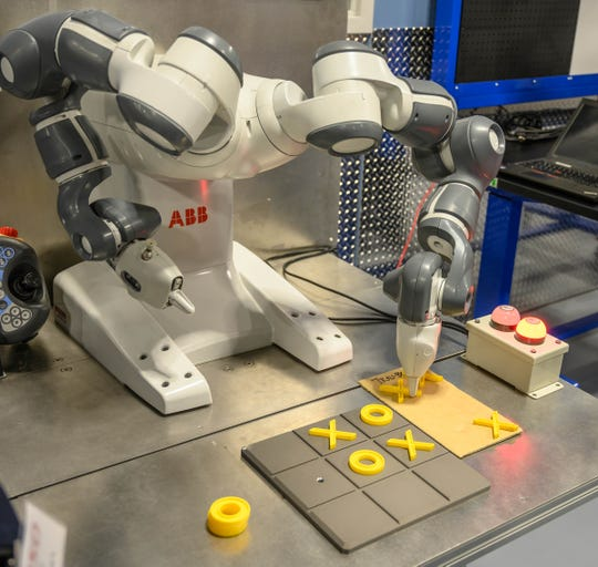 This robot played tic tac toe with guests at the ribbon-cutting ceremony for the opening of Denso's new North Technical Training Center on Friday.