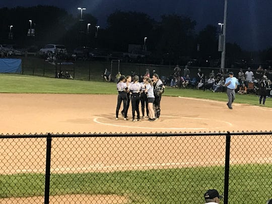 Corning players gather in the circle during the fifth inning of Thursday's Class AA state first-round playoff game against Warwick at Middletown High. The Hawks won, 6-4.