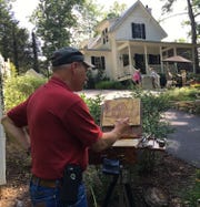 Plein Air Painter Bryan Koontz has a perfect view of the home and garden of Joyce and Fritz Ackerman on last year's Art in Bloom Garden Tour. This year's tour is June 14 and 15 from 10 a.m. to 2 p.m.