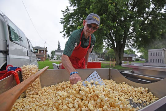 Scott Isaac of Willard works the Bazinga Kettlecorn booth at the Dutchtown Farmers Market on Thursday.