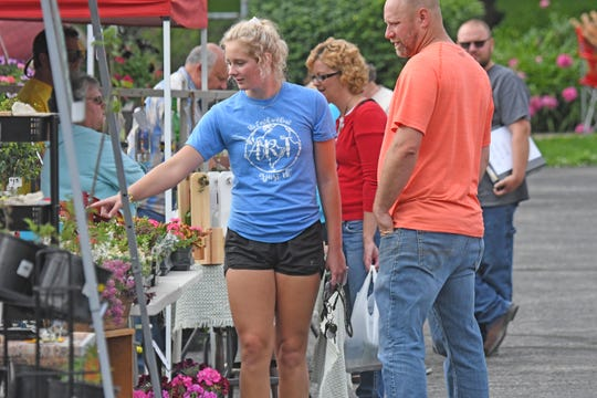 Visitors shopped booths containing flowers, herbs, vegetables, fruits, sweets, meats and much more at the Dutchtown Farmers Market in New Washington.