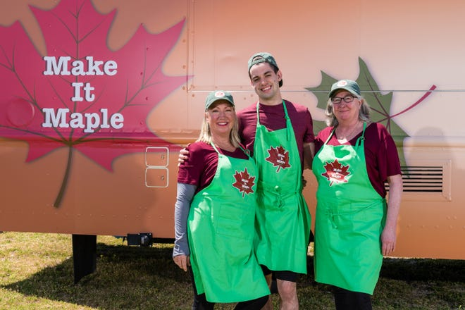 The Make it Maple  team pose for team portraits in front of their truck, as seen on The Great Food Truck Race, Season 10.