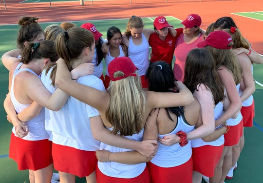 Champlain Valley girls tennis coach Amy deGroot, second from right, addresses her team after their victory over South Burlington for the Division I state championship on Tuesday in Shelburne.